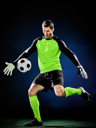 portero futbol: one caucasian goalkeeper soccer man isolated on black background