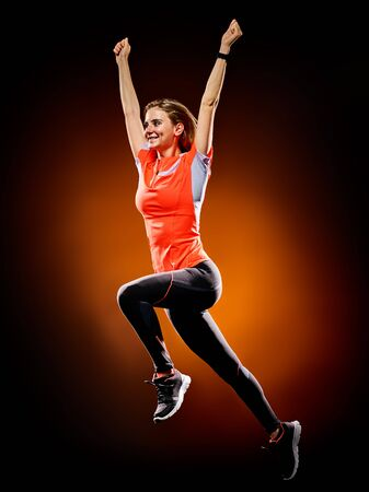 cheer full: one caucasian young woman runner running jogger jogging isolated on black brackground Stock Photo