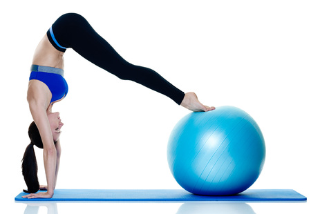 exercices: one caucasian woman exercising fitness pilates exercices isolated on white background Stock Photo