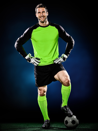 arquero de futbol: one caucasian goalkeeper soccer man isolated on black background