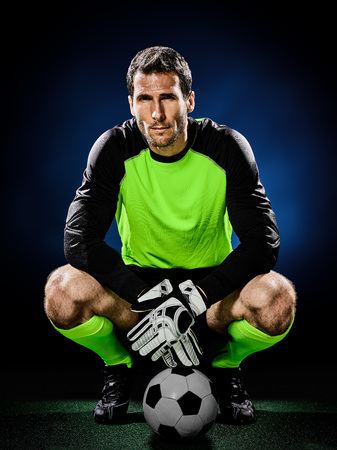 arquero: one caucasian goalkeeper soccer man isolated on black background