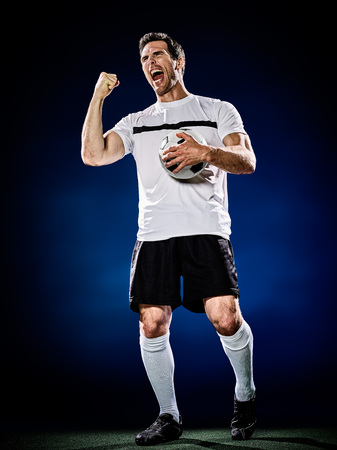 cheer full: one caucasian soccer player man isolated on black background