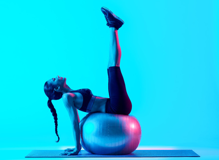 exercices: woman fitness pilates exercices isolated Stock Photo