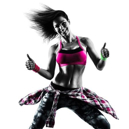 Una mujer caucásica bailando zumba ejercicios de fitness bailarina aislado en la silueta en el fondo blanco Foto de archivo - 70504132