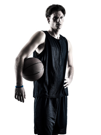 shadow silhouette: one caucasian basketball player man isolated in silhouette shadow on white background