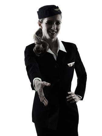 manos estrechadas: one caucasian Stewardess cabin crew  woman Handshaking isolated on white background in  silhouette