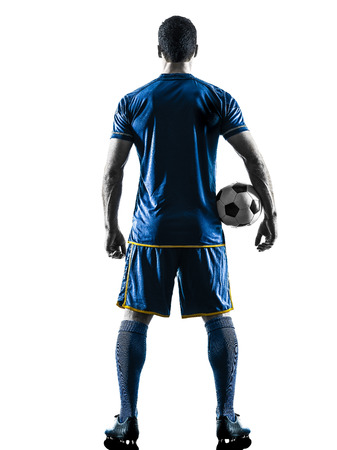 one caucasian soccer player man standing Rear View in silhouette isolated on white background Stock Photo - 74792022