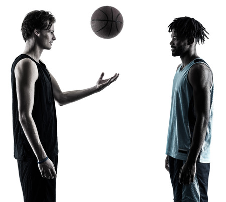 two basketball players men isolated in silhouette shadow on white background Stok Fotoğraf - 77394561