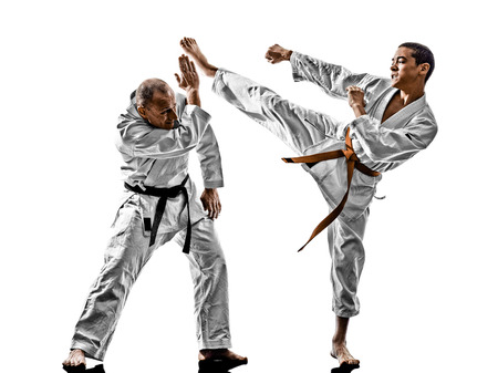 two karate men sensei and teenager student fighters fighting isolated on white background Stok Fotoğraf - 78253413