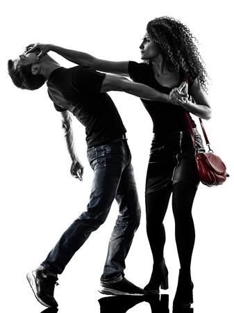 Een blanke vrouw slachtoffer van een dief aggressie zelfverdediging geïsoleerd op een witte achtergrond Stockfoto - 78933056