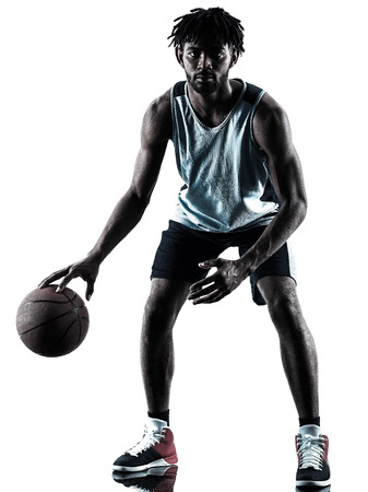 one afro-american african basketball player man isolated in silhouette shadow on white background Imagens