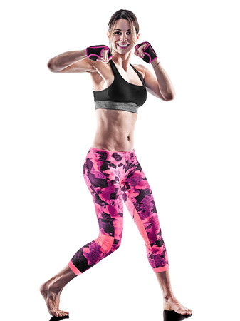 one caucasian woman exercising fitness cardio boxing pilates excercises in studio isolated on white background