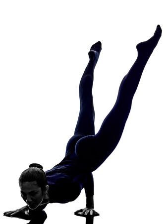 woman exercising Mayurasana peacock pose yoga silhouette shadow white background Stock Photo