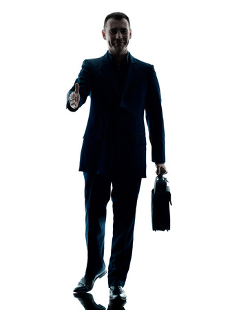 one caucasian business man walking  silhouette isolated on white background