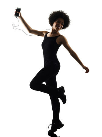 one mixed race african young teenager girl woman happy dancer dancing  listening music in studio shadow silhouette isolated on white background 版權商用圖片