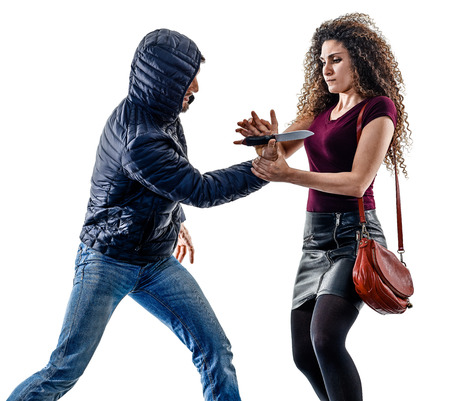 one caucasian woman victim of a thief aggression self defense isolated on white background Zdjęcie Seryjne - 80700873