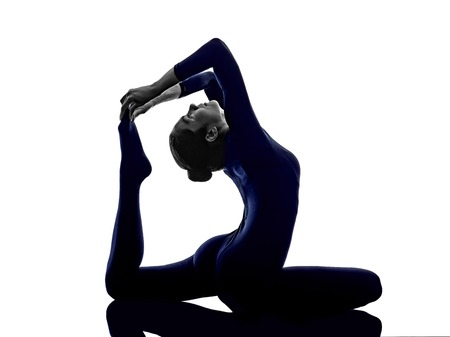 woman exercising Eka Pada Rajakapotasana One Legged King Pigeon pose yoga silhouette shadow white background