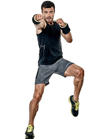 one caucasian fitness man exercising cardio boxing exercises in studio  isolated on white background Archivio Fotografico