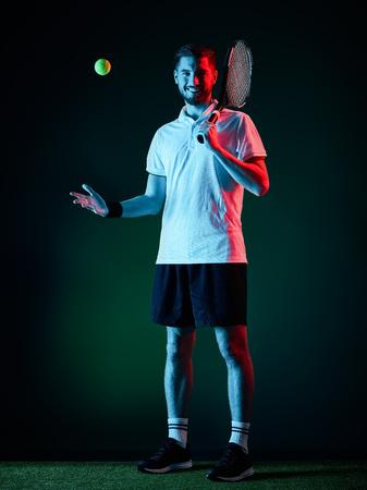 one caucasian tennis player man studio isolated on black background photo