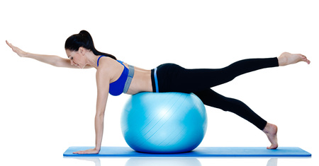 one caucasian woman exercising fitness pilates exercices isolated on white background Stock Photo