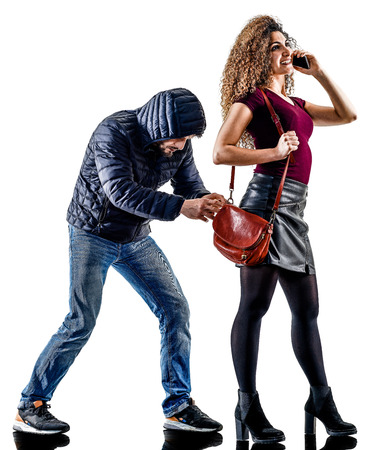 een blanke vrouw slachtoffer van een dief aggressie zelfverdediging geïsoleerd op een witte achtergrond Stockfoto