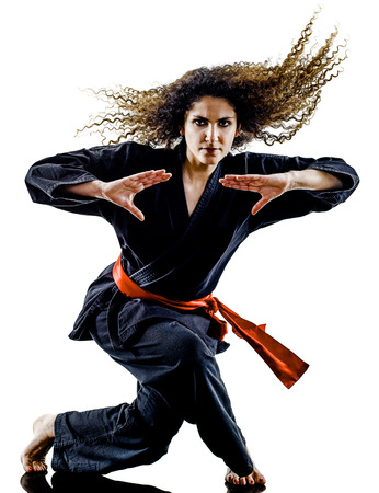 one caucasian woman practicing martial arts Kung Fu Pencak Silat in studio isolated on white background Banco de Imagens