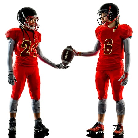 two women teenager girls american football players  isolated on white background silhouette with shadows Stock Photo
