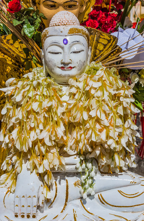 buddha statue Shwedagon Pagoda Yangon in Myanmar Stock Photo