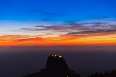 sunset over high sacred place of Mount Popa Myanmar