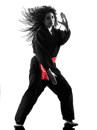 one caucasian woman practicing martial arts Kung Fu Pencak Silat in studio isolated on white background Stock Photo