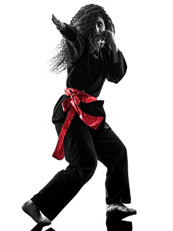 one caucasian woman practicing martial arts Kung Fu Pencak Silat in studio isolated on white background Reklamní fotografie