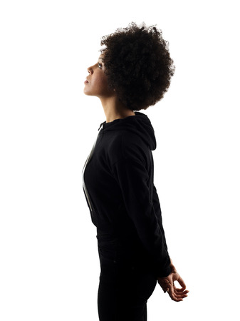 one mixed race african young teenager girl woman looking up in studio shadow silhouette isolated on white background