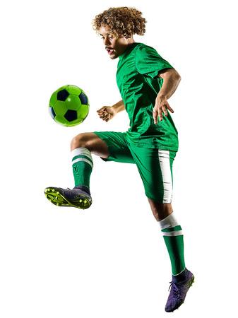 白い背景に隔離されたシルエットで遊ぶ1つの混合レース若いティーンエイジャーサッカー選手の男 写真素材