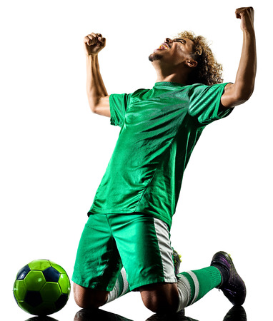 one mixed race young teenager soccer player man celebration  in silhouette isolated on white background Stock Photo