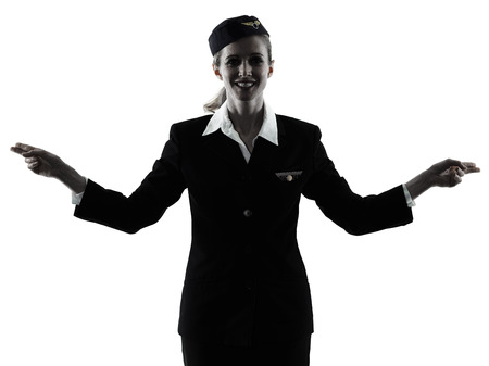 one caucasian Stewardess cabin crew  woman pointing showing isolated on white background in  silhouette Stock Photo
