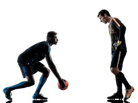two soccer players goalkeeper men in studio silhouette isolated on white background Stok Fotoğraf