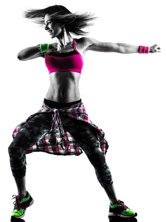 one caucasian woman cardio fitness exercises dancer dancing isolated in silhouette on white background