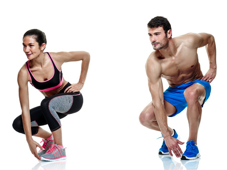 one caucasian couple man and woman exercising fitness exercises isolated on white background Foto de archivo