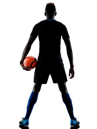 Ein afrikanischer Fußballspieler Mann spielt im Studio isoliert auf weißem Hintergrund Standard-Bild - 94423959