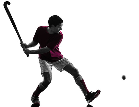 one caucasian field hockey player man isolated silhouette on white background Standard-Bild