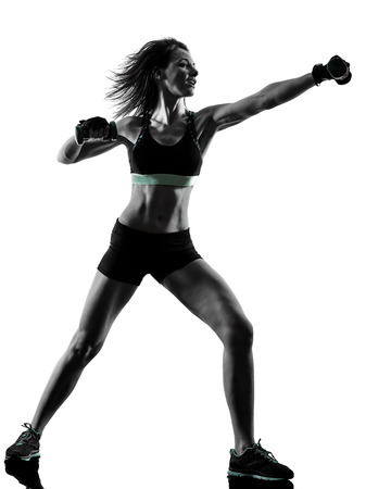 one caucasian woman exercising cardio boxing cross core workout fitness exercise aerobics silhouette isolated on white background 写真素材 - 95040724