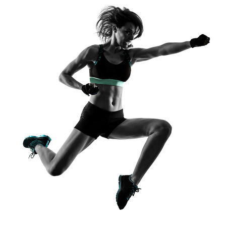 one caucasian woman exercising cardio boxing cross core workout fitness exercise aerobics silhouette isolated on white background 스톡 콘텐츠