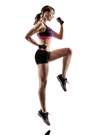 one caucasian woman exercising cardio boxing cross core workout fitness exercise aerobics silhouette isolated on white background Stock Photo