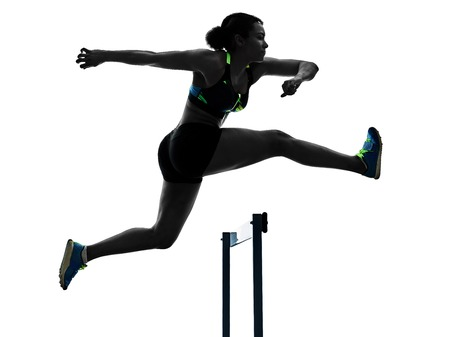 one african runner running hurdlers hurdling  woman isolated on white background silhouette Фото со стока - 95040721