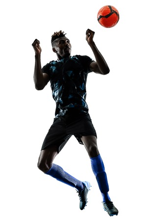 one african soccer player man playing in studio isolated on white background Reklamní fotografie - 95583027