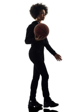 one mixed race african young teenager girl woman basketball players in studio shadow silhouette isolated on white background Imagens - 95635444