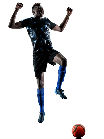 one african soccer player man playing in studio isolated on white background Stock Photo