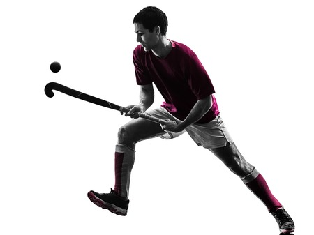 one caucasian field hockey player man isolated silhouette on white background 스톡 콘텐츠