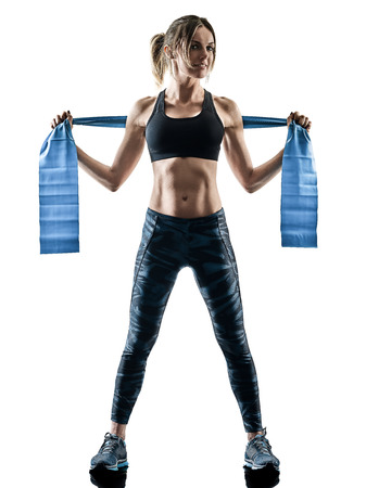 one caucasian woman exercising pilates fitness  elastic resistant band exercises isolated  silhouette on white background Reklamní fotografie - 97808234