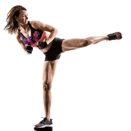 one caucasian woman exercising cardio boxing cross core workout fitness exercise aerobics silhouette isolated on white background Фото со стока